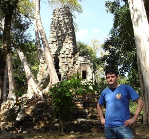 Joel Webb in front of a structure at Angkor Wat, Cambodia